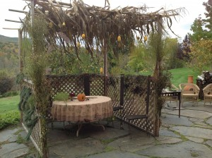 Gendlers continue to build home-grown sukkahs, replete with corn stalks and gourds.
